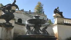 Beautiful bronze statues as water fountain stone at Linderhof Palace Germany Stock Footage