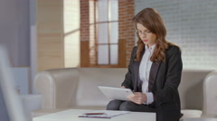Pretty business woman using tablet smiling at cam. Online dating - stock footage