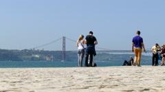 4K Portugal Lisbon Lisboa Tourist at Rio Tejo river and April 25 bridge Stock Footage