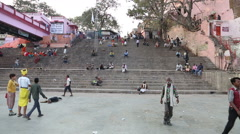 View on stairs in Varanasi, with people sitting and passing in front. Stock Footage