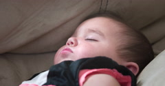 Young little baby girl sleeping on couch 4k Stock Footage