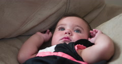 Adorable baby girl laying on couch 4k Stock Footage