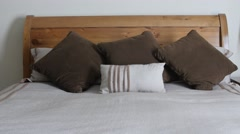 Large king size bed with pillows in a hotel room Stock Footage