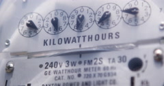 Electricity meter reader on side of house with mechanical dials 4k - stock footage