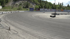 Motor sports, two sprint cars coming into corner, wide Stock Footage
