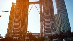 KUALA LUMPUR, MALAYSIA - CIRCA FEB 2015: Petronas Twin Towers dominate the sk Stock Footage
