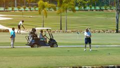 LANGKAWI, MALAYSIA - CIRCA FEB 2015: Tourist enjoying a game of golf at a pop Stock Footage