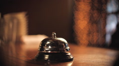 Service Bell Ring on Restaurant Counter Stock Footage