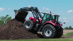 Tractor doing landscaping work Stock Footage