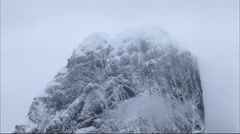 A mist covered mountain in the Gerlach Straits in Antarctica - stock footage