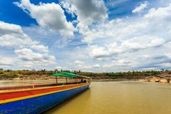 Big boat for transport on khong river - stock photo