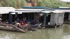 Sailing past a floating village on the Mekong river close pass-by Stock Footage