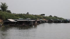 Sailing towards a floating village on the Mekong river final approach Stock Footage