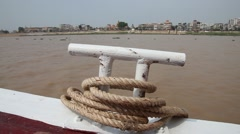 Tonle Sap rboat with rope and handle float-by riverside Stock Footage