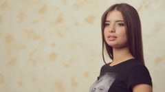 Stock Video Footage of Young beautiful model posing for a photographer at a photo shoot