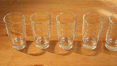 Hovering over many shot glasses Stock Footage