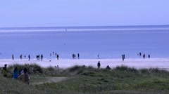 Sandy beach with tourist - Lewis, Outer Hebrides, UK Stock Footage