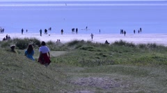Tourists at sandy beach at  Lewis, Outer Hebrides, UK Stock Footage