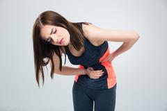 Fitness woman having pain in stomach - stock photo