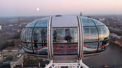 Tourists visit in the London Eye during sunset in London Stock Footage