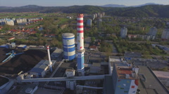 AERIAL: Power station in big industrial city at sunset Stock Footage