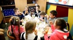 Children Birthday party in McDonald`s restaurants. Children eating fastfood Stock Footage