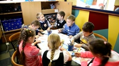Many children drawing. birthday party in fastfood restaurant Stock Footage