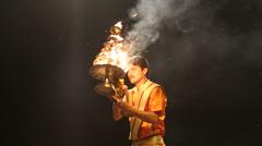 Hindu priest performing with fire at Ganga Aarti ritual in Varanasi. Stock Footage