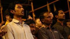 Indian men singing at Ganga Aarti ritual in Varanasi. Stock Footage