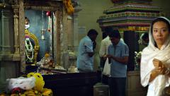 SINGAPORE - CIRCA JAN 2015: Hindu priests and worshippers inside a temple in Stock Footage