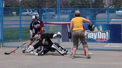 Coed ball hockey in game action Stock Footage