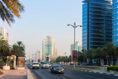 Light traffic along a major, arterial highway through metropolitan Dubai - stock photo