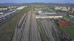 AERIAL: Huge freight train terminal on cargo station in industrial city Stock Footage