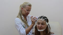 EEG: Electroencephalography devise in work - stock footage