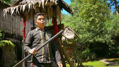 BORNEO, MALAYSIA - CIRCA JAN 2015: Professional tour guide explains and demon Stock Footage