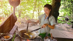 BORNEO, MALAYSIA - CIRCA JAN 2015: Woman demonstrating the production of a tr Stock Footage