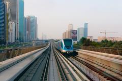 DUBAI, UAE - 16 JULY 2014: Passenger train cruising along Dubai's ultra-moder - stock photo