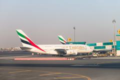 Emirates Airlines jumbo jet aircraft at Dubai International Airport Stock Photos