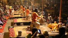Crowd watching hindu priests performing at Ganga Aarti ritual in Varanasi. Stock Footage