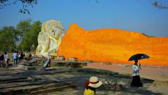 AYUTTHAYA, THAILAND - CIRCA FEB 2015: Tourists gather to view an enormous Bud Stock Footage