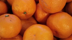 Panning fruit background of mandarins Stock Footage
