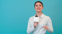 Beautiful girl TV journalist with pretty smile is reporting Stock Footage