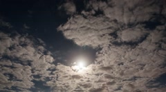 A timelapse shot of the full moon on a cloudy night. Stock Footage