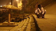 Old man at ghats of the Ganges river in Varanasi in the night time. Stock Footage