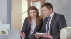 Stock Video Footage of Sales manager convincing client businessman to complete a deal