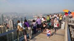 Tourists on a observation platform Tower Victoria Peak in Hong Kong Stock Footage