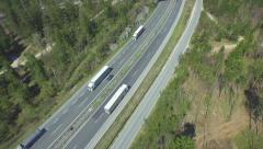 AERIAL: Trucks and cars driving on a freeway Stock Footage