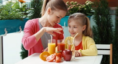 Happy family promoting healthy juice and looking at camera Stock Footage