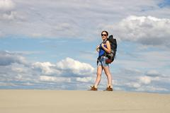 beautiful girl hiker in desert - stock photo