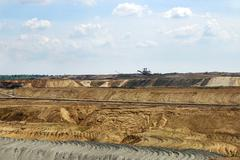 open pit coal mine with excavators landscape - stock photo